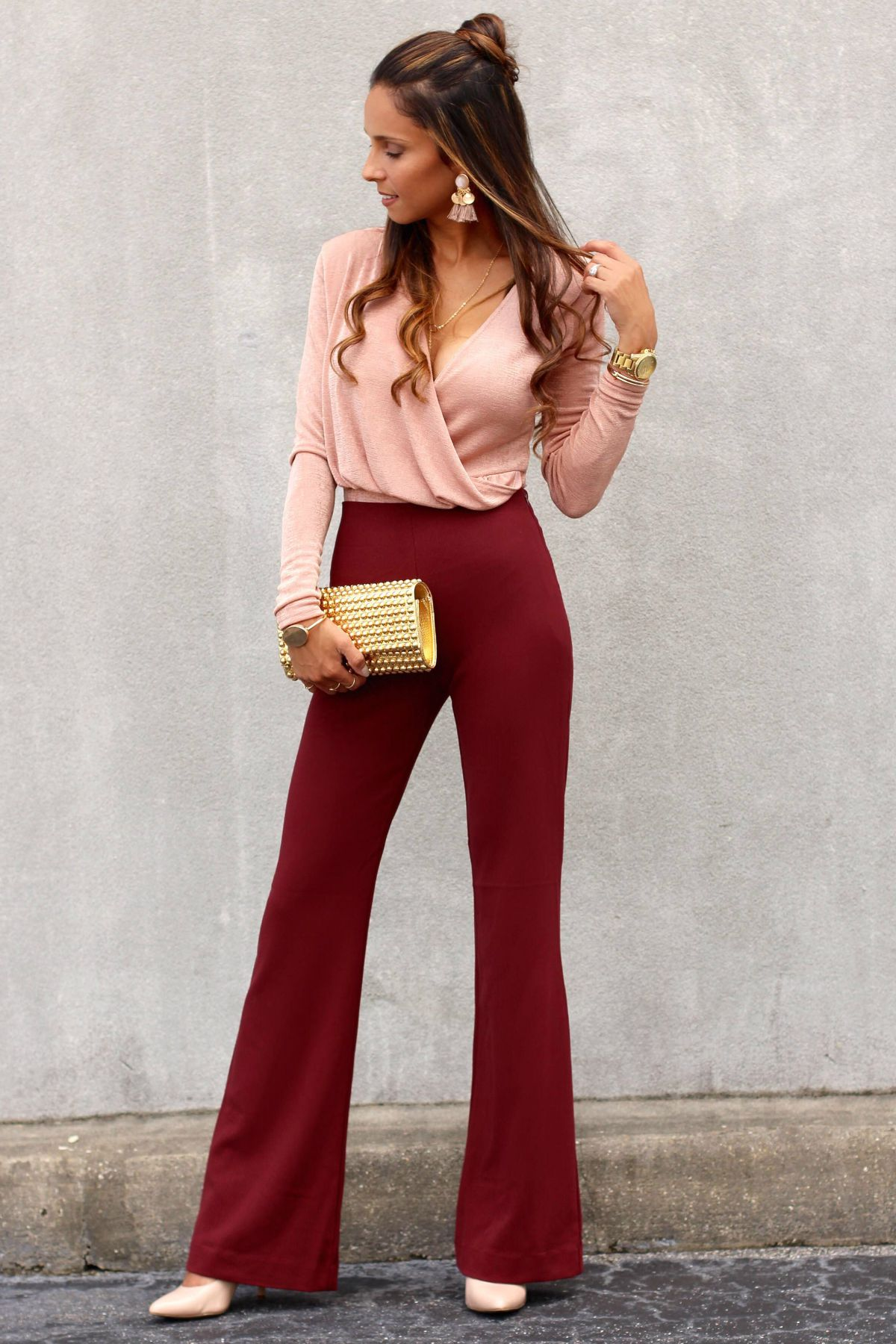 blush bodysuit paired with burgundy high-waist pants