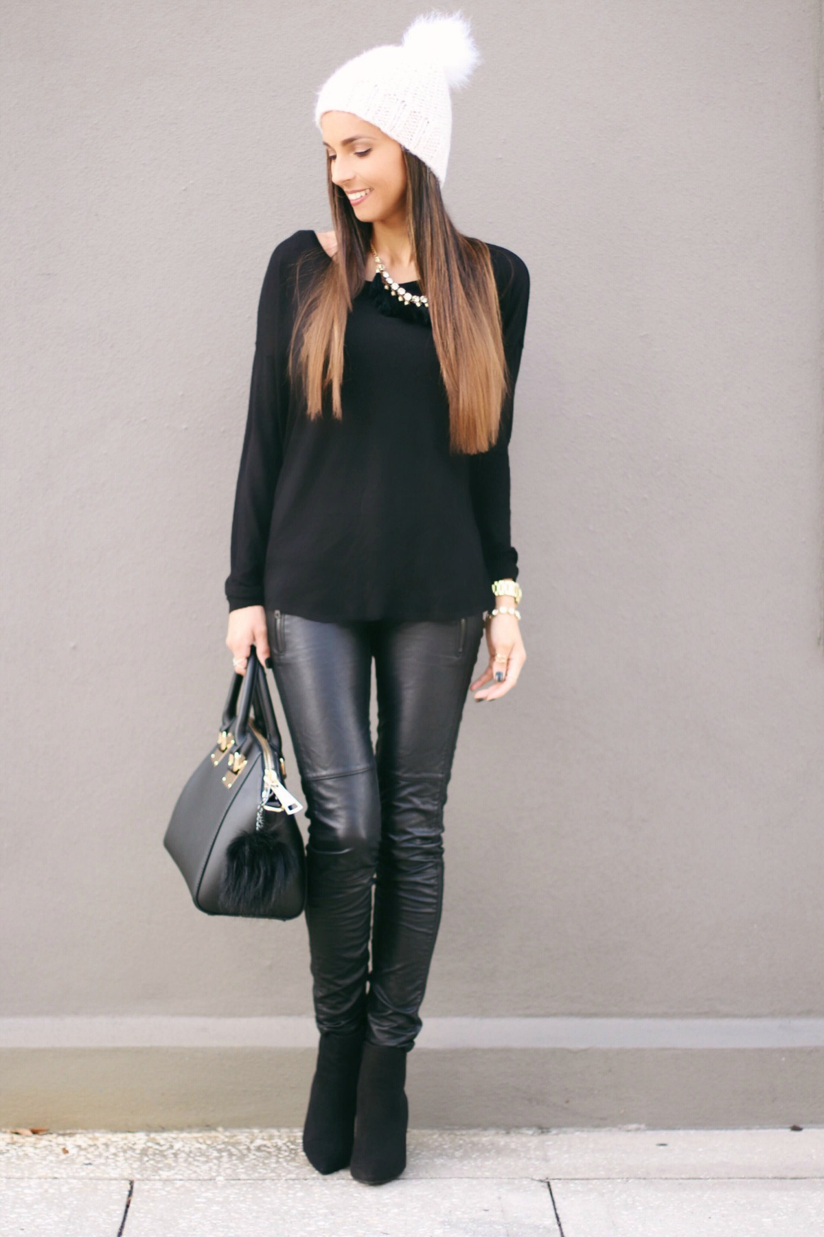 Black leather pants and white beanie hat