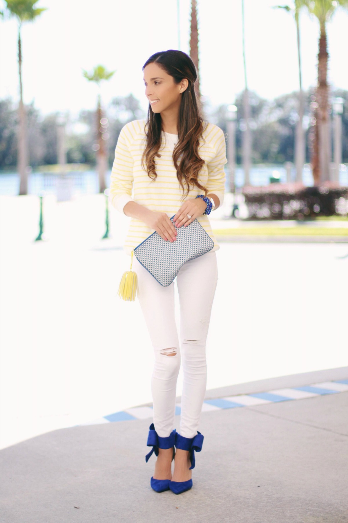 Yellow and White Stripe Sweatshirt with white ripped jeans and blue bow heels