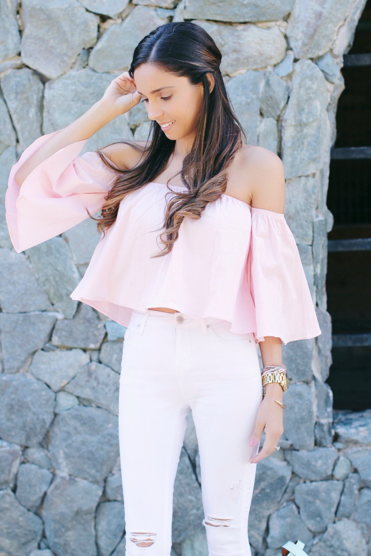 Thalia pink off the shoulder crop top with white ripped jeans