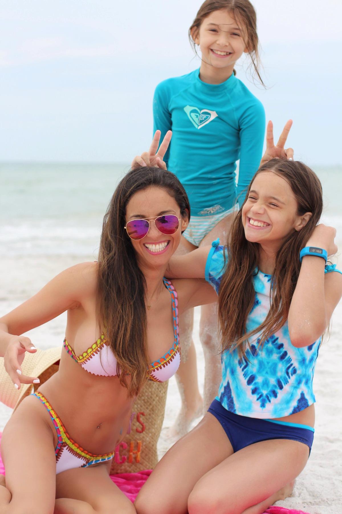 White neoprene brazilian cut bikini with crochet details