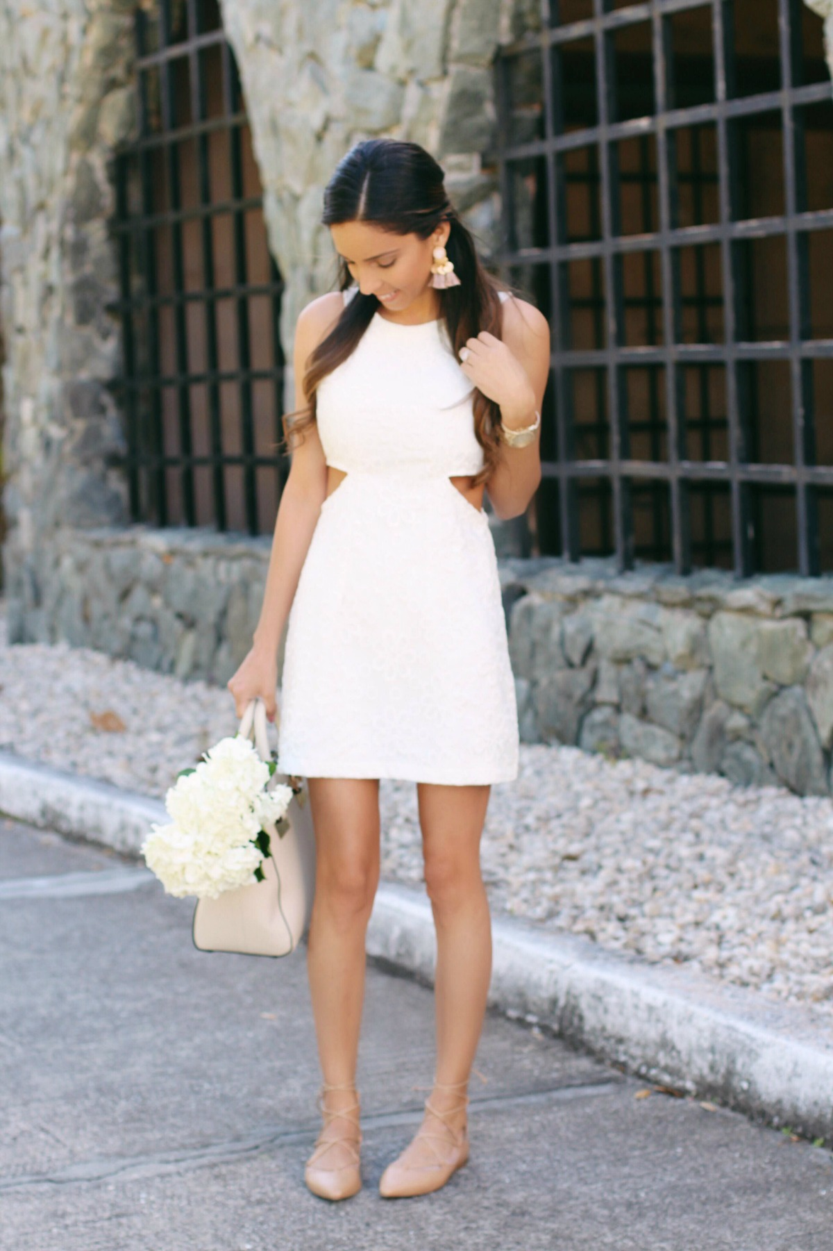 Little white lace cut out dress with nude lace up flats, neutral bag and gold accents