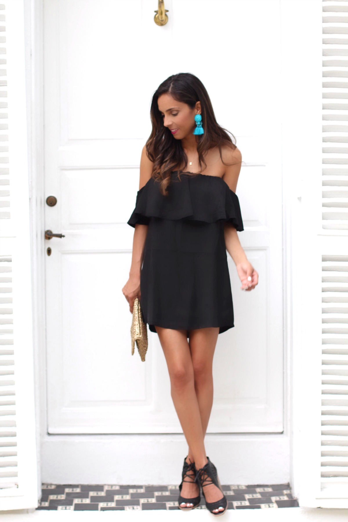 Black off the shoulder dress with turquoise accessories