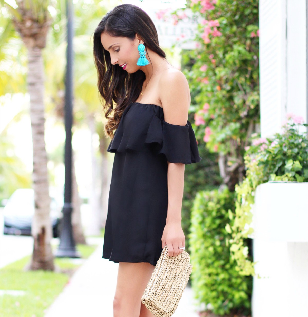 off the black dress with turquoise tassel earrings