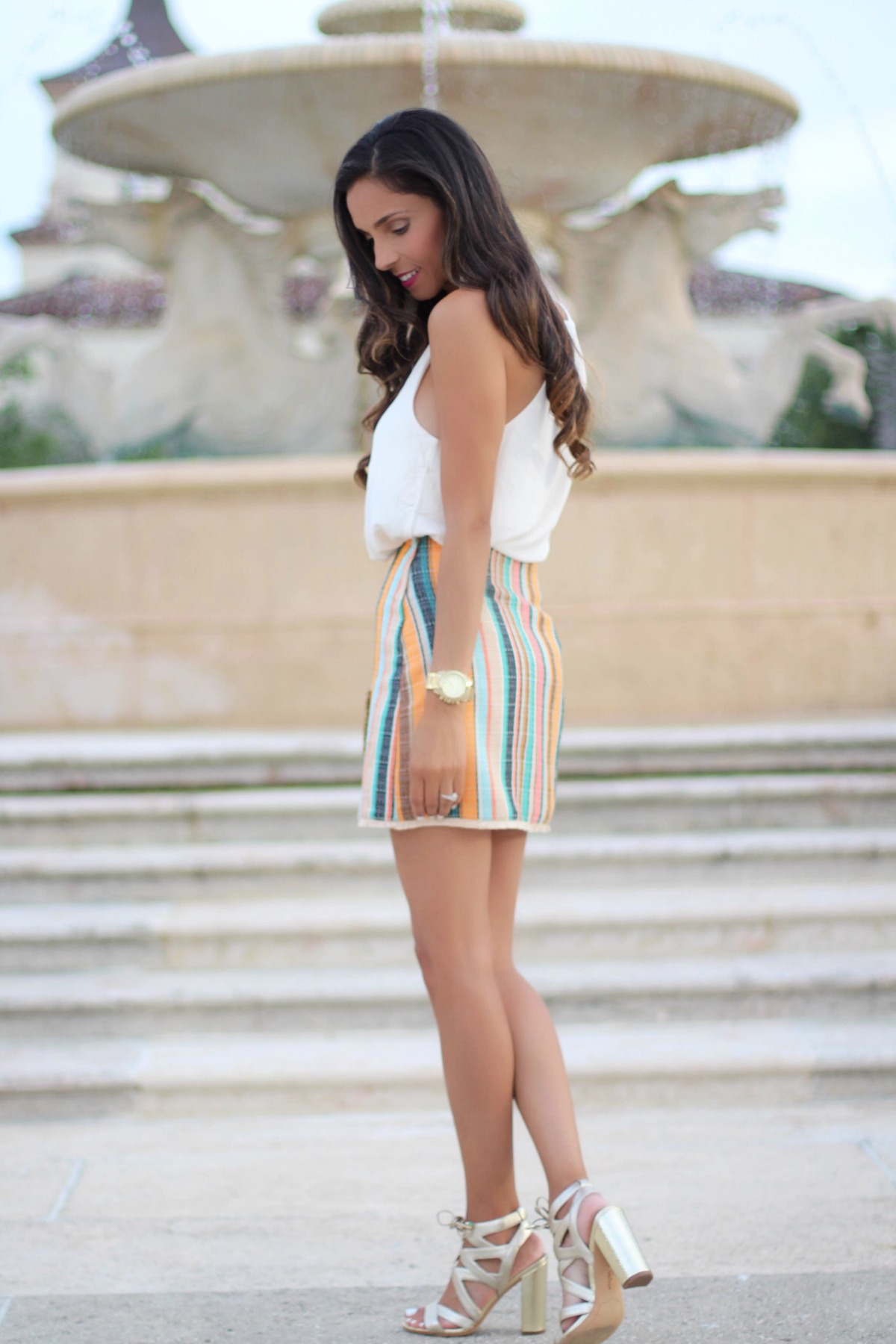 White v-neck camisole top and multicolor striped skirt in Palm Beach, FL