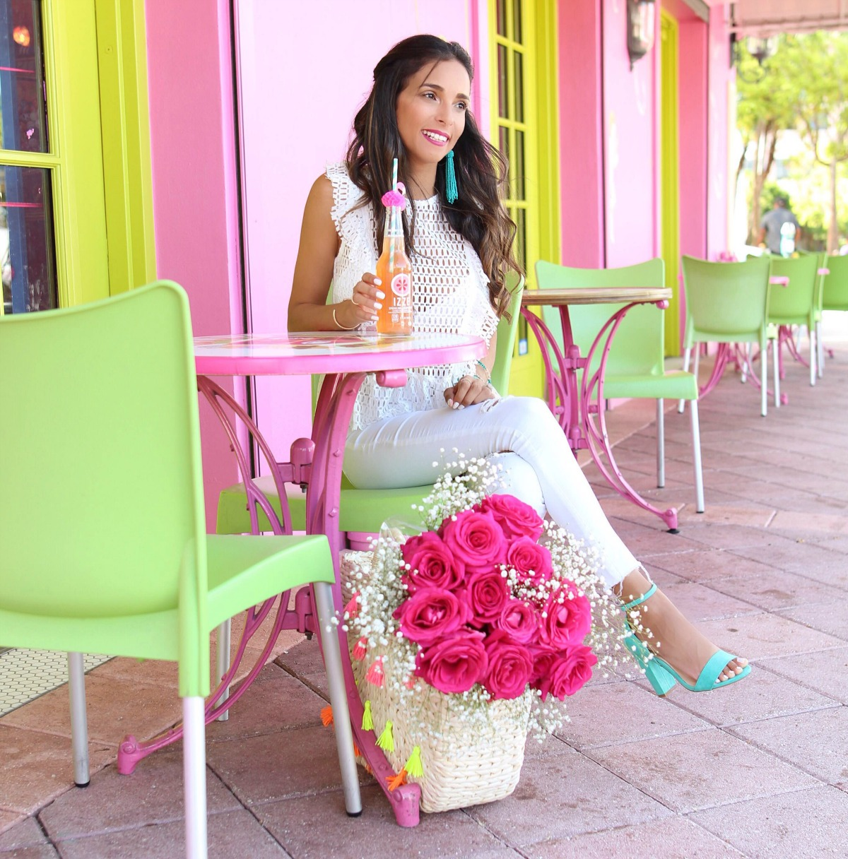 White peplum eyelet top with white jeans and a pop of color for accessories