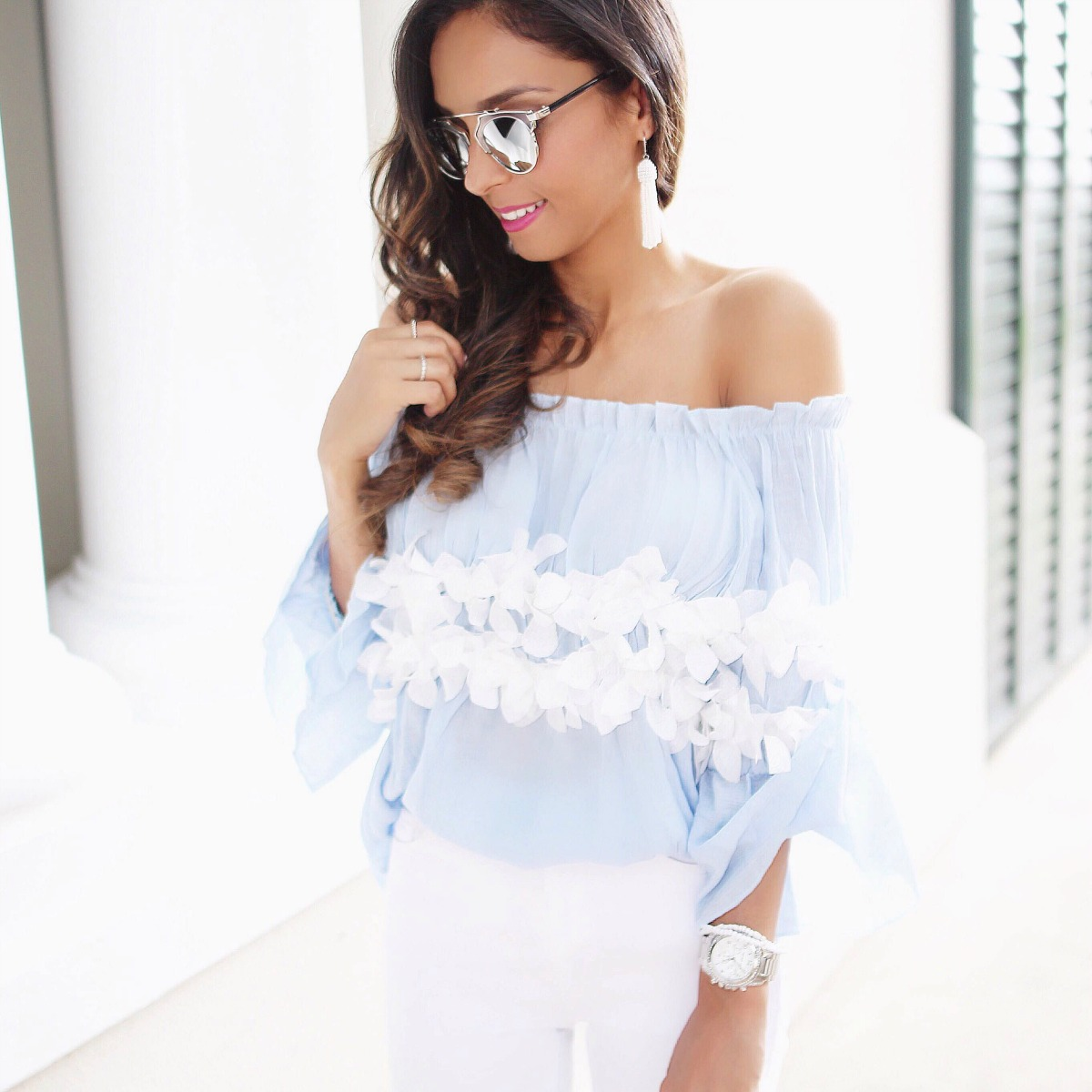 Light blue off the shoulder top with trimmed flower detail and white jeans