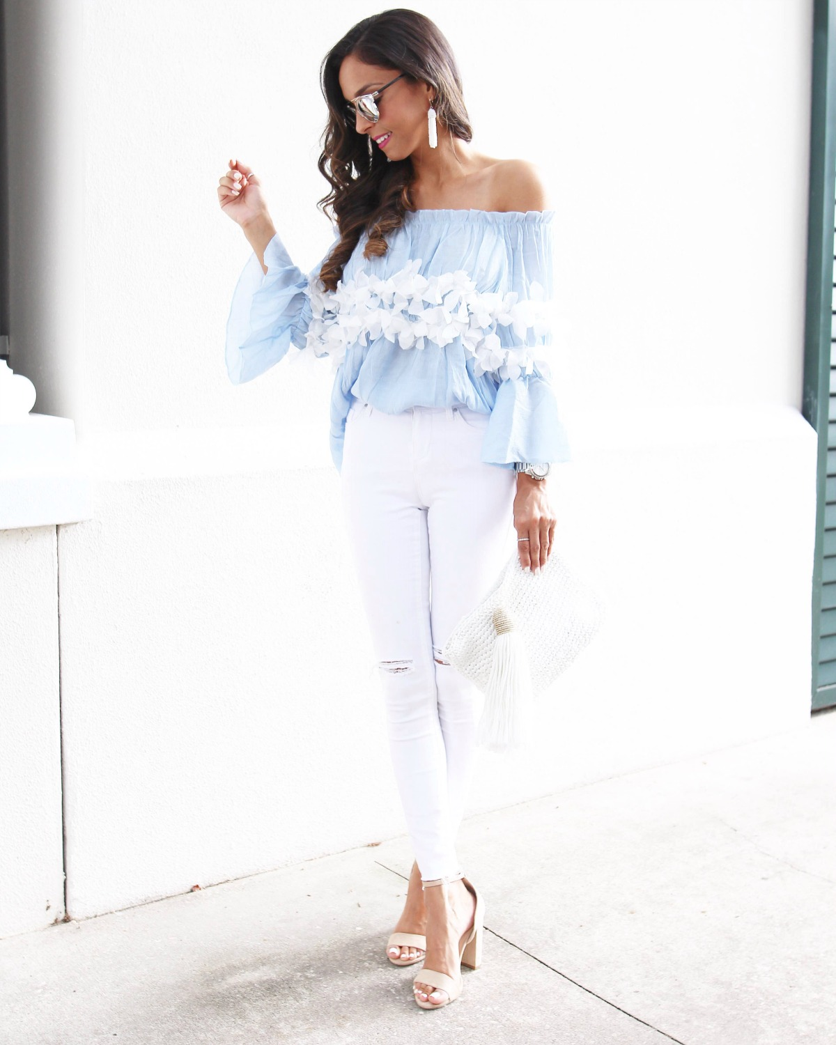 c29df7c0c1ab92 Light blue off the shoulder top with trimmed flower detail and white jeans
