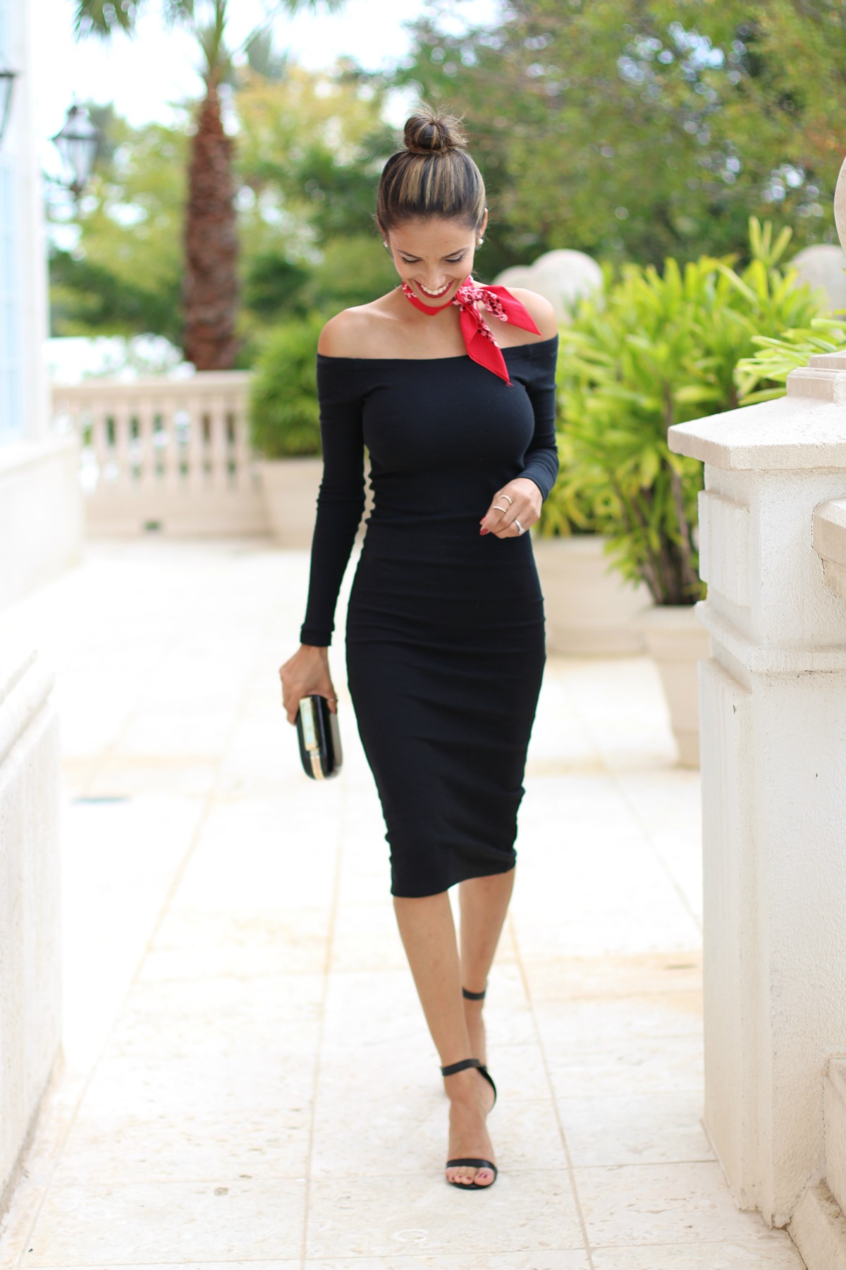 Off the shoulder little black dress with red bandanna and strappy heels