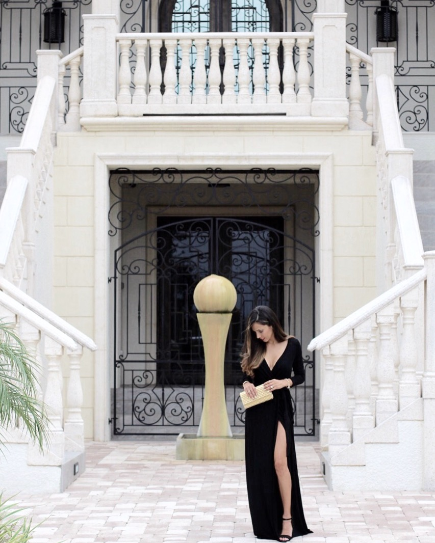 Black maxi dress with plunging neckline and high leg slit